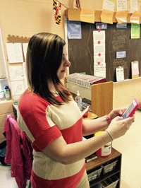 English teacher Ms. Wogman uses her new iPhone 6.