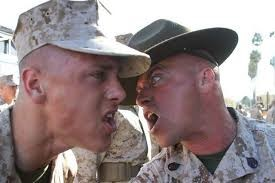 A Marine recruit receiving individual attention from a Drill Instructor.     (Photo Courtesy of www.marinecorpstimes.com)