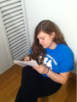 Sophomore Kate Cognard-Black writes a poem at the poetry workshop.