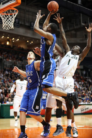 FEB. 13, 2011-Coral Gables, Florida, U.S - Duke Blue Devils guard  Nolan Smith (2) drives the ball to the hoop during  the game between Miami and Duke at Bank United Center in Coral Gables, Florida.The Duke Blue Devils defeated the Miami Hurricanes 81-71